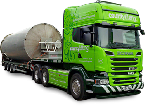 Green branded lorry carrying silo on trailer
